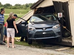Car Destroys a Shed at Health Care Rally