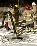 Firefighters Train Under Frozen Conditions